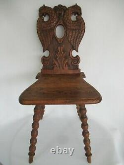 Antique hand-carved Black Forest chair around 1880, double-headed eagle, grimaci