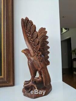 Hand-carved Folk Art Wooden Eagle Sculpture 18 1 piece of wood