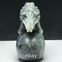 Natural mineral specimen. Labradorite. Hand-carved. Skull and a eagle sculpture