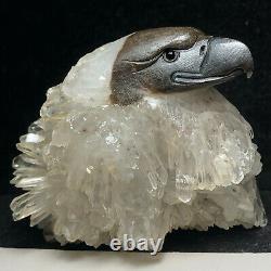 Natural quartz crystal cluster mineral specimen. Fine hand-carved bald eagle